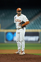 Texas Longhorns relief pitcher Donny Diaz (19) looks to his catcher for the sign against the Missouri Tigers in game eight of the 2020 Shriners Hospitals for Children College Classic at Minute Maid Park on March 1, 2020 in Houston, Texas. The Tigers defeated the Longhorns 9-8. (Brian Westerholt/Four Seam Images)