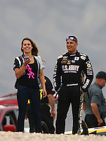 Mar 29, 2014; Las Vegas, NV, USA; NHRA top fuel driver Tony Schumacher (right) with top alcohol dragster driver Ashley Sanford during qualifying for the Summitracing.com Nationals at The Strip at Las Vegas Motor Speedway. Mandatory Credit: Mark J. Rebilas-