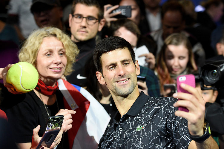 Novak Djokovic celebrate winning against John Isner with fans<br /> <br /> Photographer Hannah Fountain/CameraSport<br /> <br /> International Tennis - Nitto ATP World Tour Finals Day 2 - O2 Arena - London - Monday 12th November 2018<br /> <br /> World Copyright © 2018 CameraSport. All rights reserved. 43 Linden Ave. Countesthorpe. Leicester. England. LE8 5PG - Tel: +44 (0) 116 277 4147 - admin@camerasport.com - www.camerasport.com
