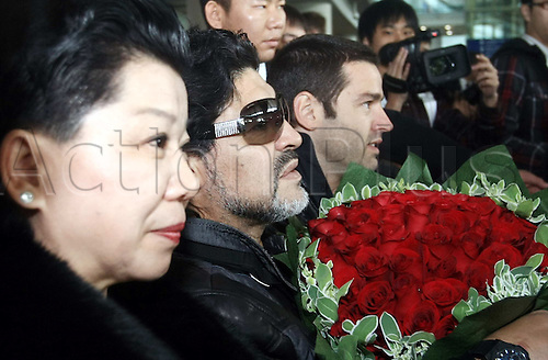 03.11.2010 Beijing, CHINA; Argentinian football legend, Diego Maradona arrives at the Beijing International Airport. He and his football players started a 10-day China tour Wednesday. In addition to the charity activities, they will have two games with Chinese players.