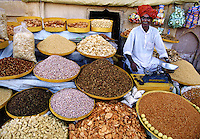 Man selling nuts Amber Fort near Jaipur India.