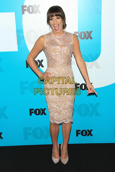 Lea Michele.The 2012 FOX Upfront After-Party at Central Park's Wollman Rink, New York, NY, USA..May 14th, 2012 .full length white cream beige lace dress sleeveless hand on hip mouth open finger pointing smiling funny .CAP/LNC/TOM.©LNC/Capital Pictures.