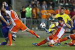 02 May 2015: Tampa Bay's Stefan Antonijevic (SRB) (in yellow) tries to get a shot past Carolina's Richard Hunter Gilstrap (left), Wes Knight (8) and Daniel Scott (2). The Carolina RailHawks hosted the Tampa Bay Rowdies at WakeMed Stadium in Cary, North Carolina in a North American Soccer League 2015 Spring Season match. The game ended in a 1-1 tie.