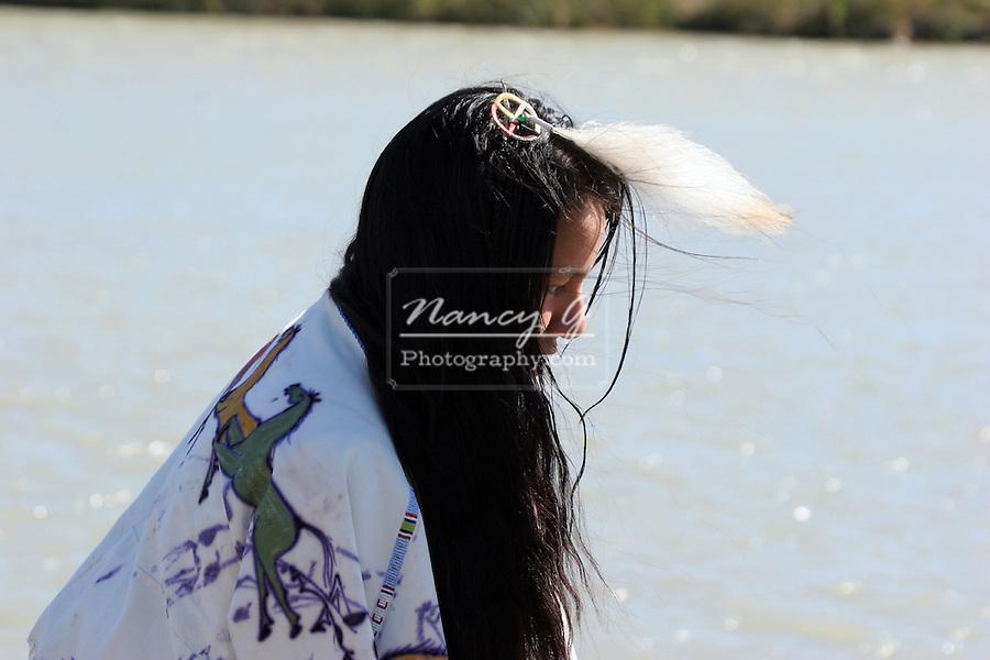 A young Native American girl walking along the rivers edge in South Dakota