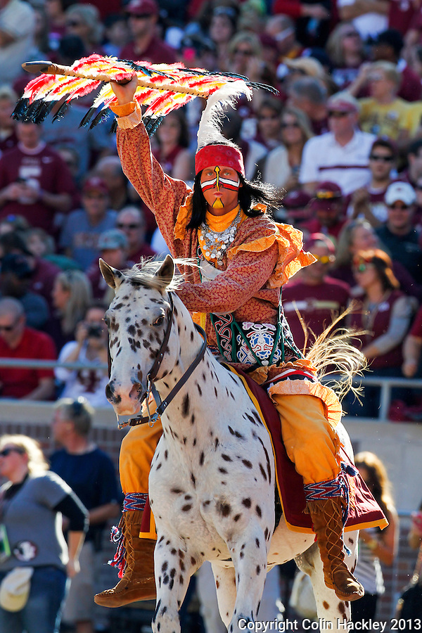 TALLAHASSEE, FLA. 10/26/13-FSU-NCSTATE102613CH-Osceola, portrayed by Florida State University student Osceola, portrayed by Drake Anderson rides Renegade through the end zone after a touchdown against North Carolina State during first half action Saturday at Doak Campbell Stadium in Tallahassee. <br /> COLIN HACKLEY PHOTO