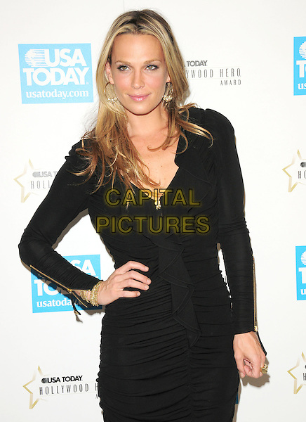 MOLLY SIMS.at The 4th annual USA TODAY Hollywood Hero Award Gala honoring Ashley Judd held at The Montage Beverly Hills in Beverly Hills, California, USA, November 10th 2009.                                                                  half length black dress gold zips  long sleeves sleeved ruched .CAP/RKE/DVS.©DVS/RockinExposures/Capital Pictures.