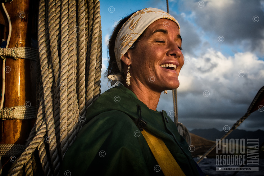 A crewmember aboard one of the Polynesian voyaging canoes with the Polynesian Voyaging Society, Pacific Ocean, September 2013.