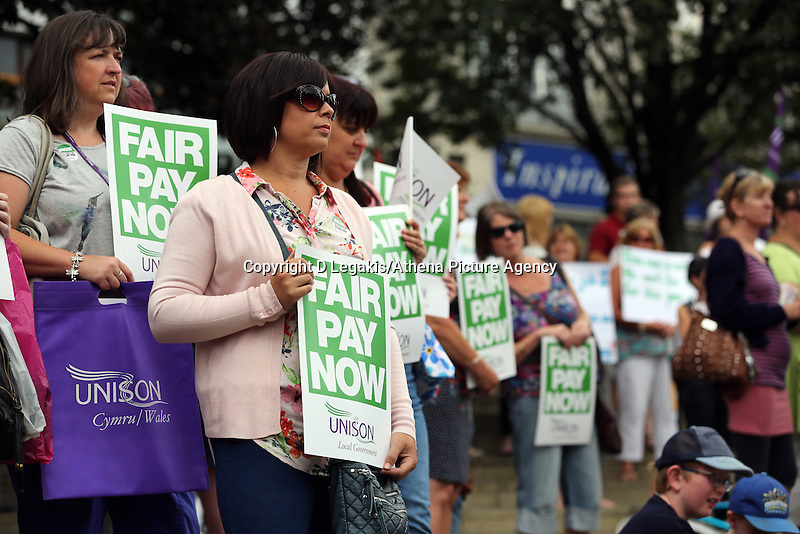 Swansea, UK. Thursday 10 July 2014<br /> Pictured: Members of the Unison workers' union at Castle Square Gardens, Swansea, south Wales.<br /> Re: Strikes are taking place across the UK in a series of disputes with the government over pay, pensions and cuts, with more than a million public sector workers expected to join the action.<br /> Firefighters, librarians and council staff are among those taking part from several trade unions, with rallies taking place across the UK.