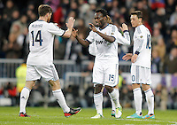Real Madrid's Xabi Alonso celebrates with Michael Essien and Mesut Özil during King's Cup match. January 15, 2013. (ALTERPHOTOS/Alvaro Hernandez) /NortePhoto