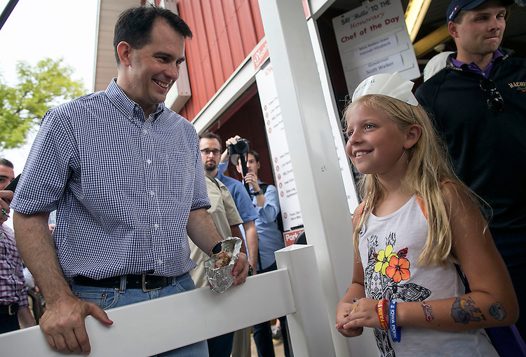 UNITED STATES - August 17: Keira Billings, 10, from West Des Moines, Iowa, is all smiles as she meets Governor of Wisconsin and Republican presidential candidate Scott Walker, at the Iowa Pork Producers Association site at the Iowa State Fair in Des Moines, Iowa, Monday, August 17, 2015. (Photo By Al Drago/CQ Roll Call)
