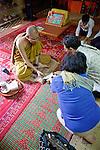 Tan Presenting Donation, Wat Bo