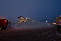 A Night at the Snow Farm<br /> Dump trucks and backhoe loaders move enormous amounts of snow, cleared from the city's streets, at Boston's largest snow farm, South Boston, MA.
