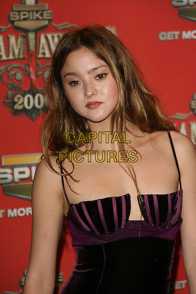 "DEVON AOKI.At Spike TV's ""Scream Awards 2006"", Press Room,. at the Pantages Theatre, Hollywood, California, USA, .7th October 2006..half length purple dress velvet.Ref: ADM/ZL.www.capitalpictures.com.sales@capitalpictures.com.©Zach Lipp/AdMedia/Capital Pictures."