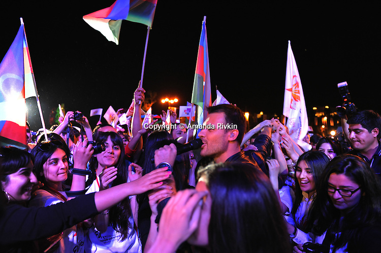 Azerbaijani pop star and son-in-law of Azerbaijan's president Emin Agalarov steps down from the stage and into a crowd of adoring fans at the Eurovision Fan Club concert on the Bulvar seaside promenade in Baku, Azerbaijan on April 29, 2012.  Emin will be performing during the Eurovision Song Contest 2012 in Baku.
