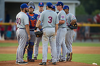 Kingsport Mets pitching coach Royce Ring (40) has a meeting on the mound with starting pitcher Jordan Humphreys (10), catcher Jose Maria (24) and the entire infield during the game against the Burlington Royals at Burlington Athletic Stadium on July 18, 2016 in Burlington, North Carolina.  The Royals defeated the Mets 8-2.  (Brian Westerholt/Four Seam Images)