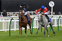 Winner of The Shadwell Dick Poole Fillies' Stakes Dark Lady (right), ridden by Pat Hobbs and trained by Richard Hannon  during Racing at Salisbury Racecourse on 5th September 2019