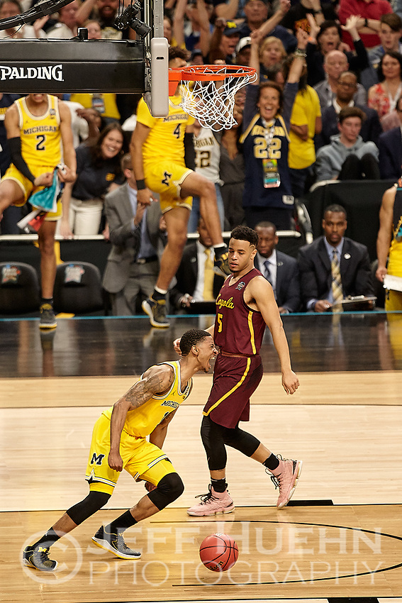 SAN ANTONIO, TX - MARCH 31, 2018: The University of Michigan Wolverines defeat the Loyola University Chicago Ramblers 69-57 in the first Semi-Final of the NCAA Men's Basketball Final Four at the Alamodome. (Photo by Jeff Huehn)