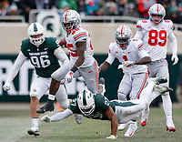 Ohio State Buckeyes running back Mike Weber Jr. (25) runs the ball past Michigan State Spartans linebacker Brandon Bouyer-Randle (26) during the third quarter of a NCAA college football game between the Michigan State Spartans and the Ohio State Buckeyes on Saturday, November 10, 2018 at Spartan Stadium in East Lansing, Michigan. [Joshua A. Bickel/Dispatch]