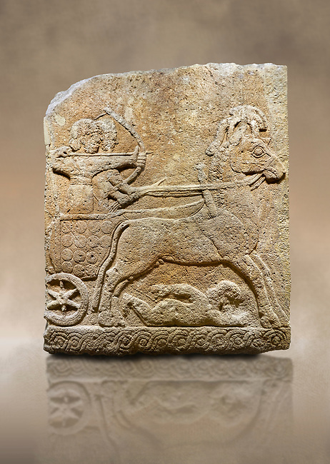 Photo of Hittite relief sculpted orthostat stone panel of Long Wall Limestone, Karkamıs, (Kargamıs), Carchemish (Karkemish), 900 - 700 B.C. Chariot. Anatolian Civilisations Museum, Ankara, Turkey<br /> <br /> One of the two figures in the chariot holds the horse's headstall while the other throws arrows. There is a naked enemy with an arrow in his hip lying face down under the horse's feet It is thought that this figure is depicted smaller than the other figures since it is an enemy soldier. The lower part of the orthostat is decorated with braiding motifs. <br /> <br /> On a brown art background.