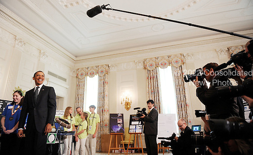 United States President Barack Obama smiles as he tours the students science fair projects exhibits in the State Dining Room of the White House October 18, 2010  in Washington DC..Credit: Olivier Douliery / Pool via CNP