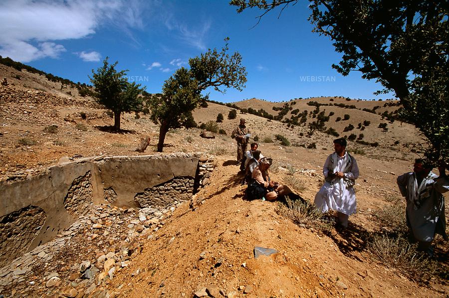 2004. Afghanistan. Ruins of Bin Laden's last known house on the side of Tora Bora mountain. Ruines de la dernière demeure connue de Ben Laden, sur le versant  afghan de la montagne de Tora Bora, après les pilonnages de l'armée américaine.