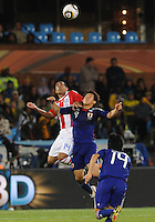 Paulo Da Silva and Shinji Okazaki contest a header. Japan and Paraguay played in the second round of the 2010 FIFA World Cup in Loftus Versfeld Stadium, in Pretoria, South Africa, June 29th. After regulation and extra time ended 0-0, Paraguay advanced to the quarterfinals, 5-3, in a penalty-kick shootout.