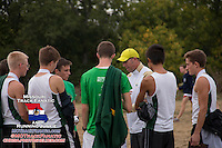 Rock Bridge Coach Neal Blackburn talks to his varsity boys squad after their runner-up finish at the 2013 Parkway West Cross Country Invitational.