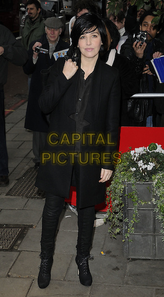 SHARLEEN SPITERI.The South Bank Sky Arts Awards, The Dorchester Hotel, London, England, UK..January 25th, 2011.full length black coat bag shirt trousers ankle boots .CAP/CAN.©Can Nguyen/Capital Pictures.