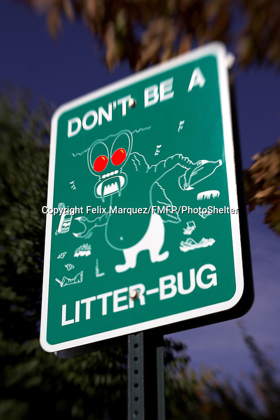 Park sign depicting a littering monster photograph using a lensbaby 2.0 lens