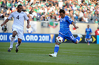 El Salvador's Lester Blanco shoots in front of Cuba's Hanier Dranguet.  El Salvador defeated Cuba 6-1 at the 2011 CONCACAF Gold Cup at Soldier Field in Chicago, IL on June 12, 2011.