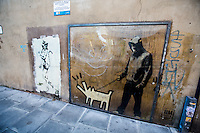 """Choose Your Weapon"" by Banksy (Homage to Keith Haring).<br /> <br /> London & Londoners 2015"