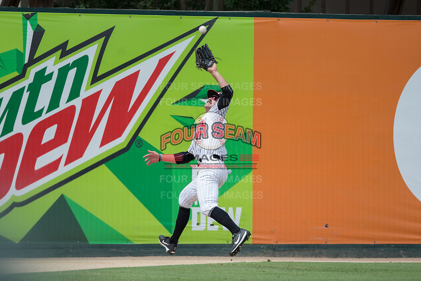 Kannapolis Intimidators left fielder Jameson Fisher (11) chases down a fly ball during the game against the West Virginia Power at Kannapolis Intimidators Stadium on June 18, 2017 in Kannapolis, North Carolina.  The Intimidators defeated the Power 5-3 to win the South Atlantic League Northern Division first half title.  It is the first trip to the playoffs for the Intimidators since 2009.  (Brian Westerholt/Four Seam Images)