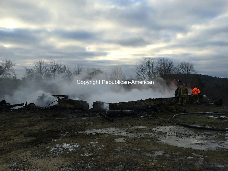 TORRINGTON, CT- 20 January 2015- 012015BJ02-- A fire that destroyed a 77-year-old barn still smoldered after bring extinguished by firefighters Tuesday morning. One llama in the barn died, according to firefighters and the farm owners, the Bottass family. Bruno Matarazzo Jr. Republican-American