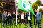 Green Flag Day : Minister Jimmy Deenihan raises the Green Flag at Colaiste na Riochta, Listowel on Monday last.