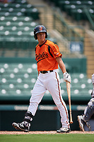 GCL Orioles pinch hitter Guiyuan Xu (21) walks back to the dugout after striking out during a game against the GCL Rays on July 21, 2017 at Ed Smith Stadium in Sarasota, Florida.  GCL Orioles defeated the GCL Rays 9-0.  (Mike Janes/Four Seam Images)