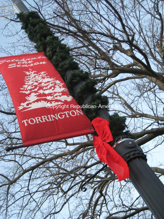 TORRINGTON, CT - 111908MO02 - 19 November 2008 - The red bows adorning city light posts along Main and Water Streets this year were donated by Carl Muller, the owner of Carl's TruValue hardware store. Jim Moore Republican-American