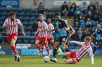 Tom Conlon of Stevenage tackles Rowan Liburd of Wycombe Wanderers during the Sky Bet League 2 match between Wycombe Wanderers and Stevenage at Adams Park, High Wycombe, England on 12 March 2016. Photo by Andy Rowland/PRiME Media Images.