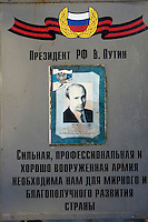 "Kamenka, Karelia, Russia, 14/12/2007..A portrait of Russian President Vladimir Putin at the headquarters of the 138th Guards Motorised Rifle Brigade with the quote ""A strong, professional and well-equipped army is necessary for our peaceful and successful development of the country"". The brigade was taking art in Snezhinka [Snowflake] 2007, a joint live fire training exercise for Russian and Swedish motorised infantry in which they play the roles of a combined peace-keeping force enforcing a demilitarised zone in a warring region."