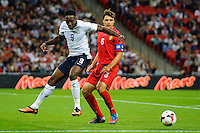 06.09.2013 London, England. England Forward Danny Welbeck (Manchester United) and Moldova Defender Alexandru Epureanu (capt) (Anzhi Makhachkala) compete for the ball during the second half of the 2014 FIFA World Cup Qualifier between England and Moldova at Wembley Stadium.