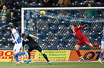 Kris Boyd's header comes off the bottom of the bar