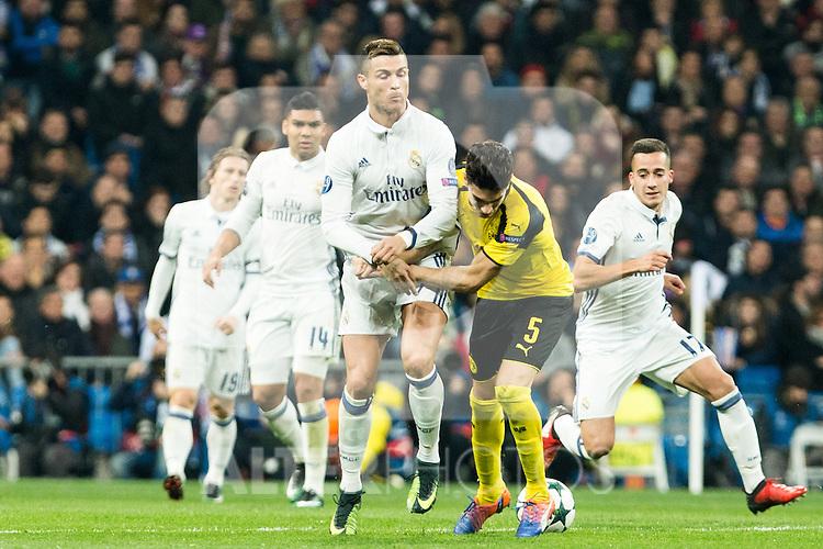 Real Madrid's Cristiano Ronaldo, Borussia Dortmund Marc Bartra during Champions League match between Real Madrid and Borussia Dortmund  at Santiago Bernabeu Stadium in Madrid , Spain. December 07, 2016. (ALTERPHOTOS/Rodrigo Jimenez)