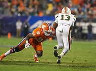 Charlotte, NC - December 2, 2017: Clemson Tigers linebacker Kendall Joseph (34) tackles Miami Hurricanes running back DeeJay Dallas (13) during the ACC championship game between Miami and Clemson at Bank of America Stadium in Charlotte, NC. Clemson defeated Miami 38-3 for their third consecutive championship title. (Photo by Elliott Brown/Media Images International)
