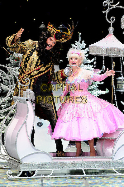 DAVID HASSELHOFF & BARBARA WINDSOR .First Family Entertainment theatre company's annual group Pantomime photocall at Piccadilly Theatre, London, England..November 26th, 2010.stage costume panto pantomime full length captain hook fairy godmother carriage sitting pink dress gold wig jacket mouth open funny .CAP/CAS.©Bob Cass/Capital Pictures.