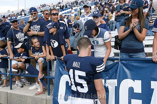 Provo - BYU vs. Wyoming college football, Saturday, September 20, 2008, at BYU's Edwards Stadium. BYU quarterback Max Hall (15) with fans, kissing girlfriend/wife