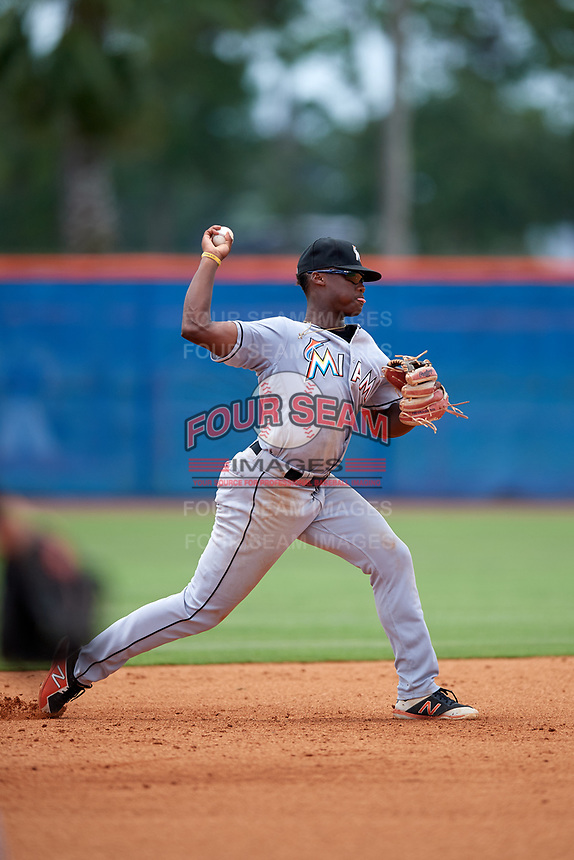 GCL Marlins shortstop Osiris Johnson (9) throws to first base during a game against the GCL Mets on August 3, 2018 at St. Lucie Sports Complex in Port St. Lucie, Florida.  GCL Mets defeated GCL Marlins 3-2.  (Mike Janes/Four Seam Images)