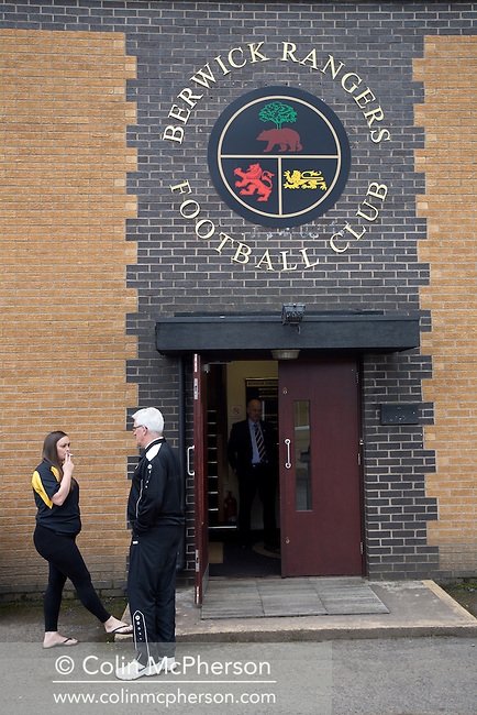 Two club officials in discussion outside the main entrance to Shielfield Park, before the Scottish League Two fixture between Berwick Rangers and East Stirlingshire. The home club occupied a unique position in Scottish football as they are based in Berwick-upon-Tweed, which lies a few miles inside England. Berwick won the match by 5-0, watched by a crowd of 509.