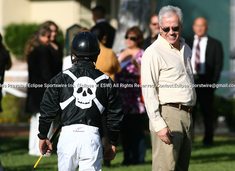 Jockey Victor Espinoza in the silks of McCormick and Son, Inc. at Hollywood Park in Inglewood, CA. November 19, 2011
