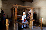 La Purisima Mission in Lompoc, California.  Mision La Purisima Concepcion de Maria Santisima was founded on December 8, 1787 by Franciscan Padre Presidente Fermin Francisco Lasuen. La Purisima was the eleventh mission of the twenty-one Spanish Missions established in what later became the state of California.  A woman dressed in period costume weaving blankets for Purisima People's Day