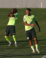 Ramires and Neymar of Brazil laugh during training ahead of tomorrow's World Cup quarter final vs Colombia tomorrow