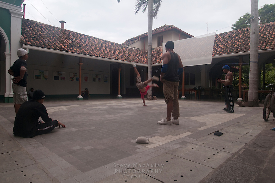 Break Dancers at interior plaza of casa de los Leones